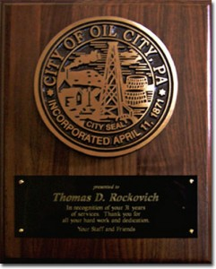 5 inch Diameter Bronze; flat relief city seal; single line border; black background; mounted on...